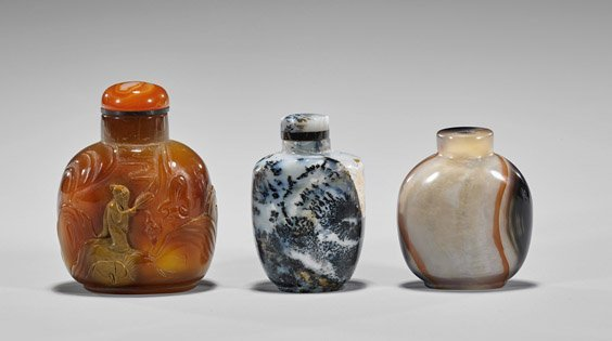 Three Carved Agate Snuff Bottles