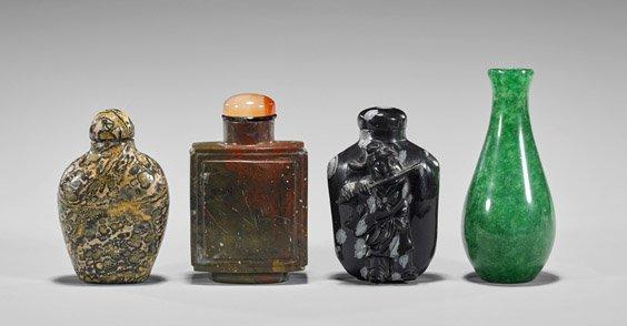 Four Carved Hardstone Snuff Bottles