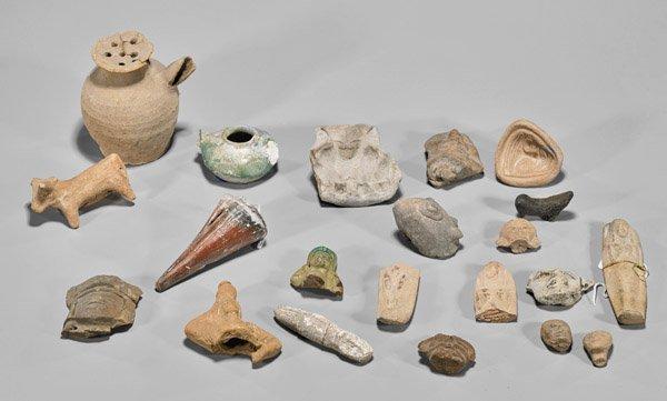 Twenty-One Moulded Pottery Vases & Figurines