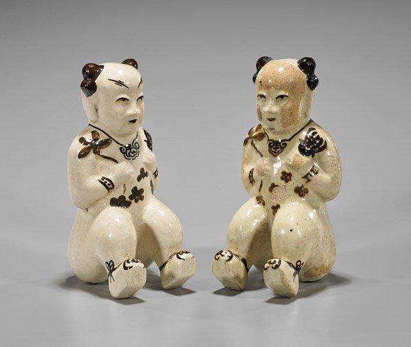 Pair Chinese Cizhou Glazed Seated Boys