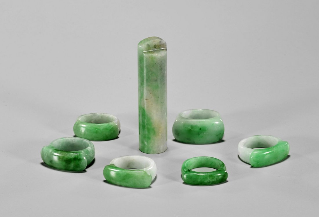 Seven Chinese Carved Jadeites: Saddle Rings & Pendant