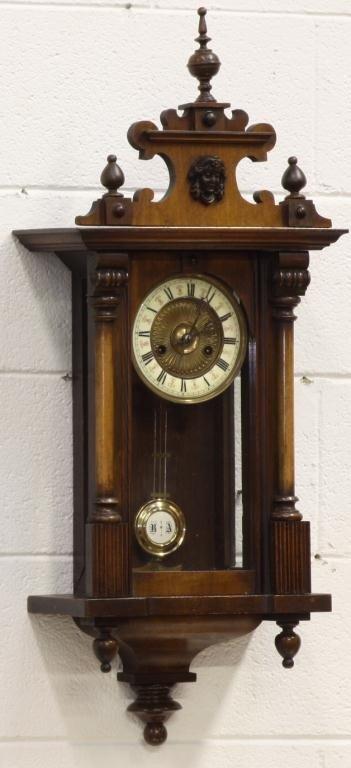 10I: 19th c. Carved Walnut R&A Clock with key