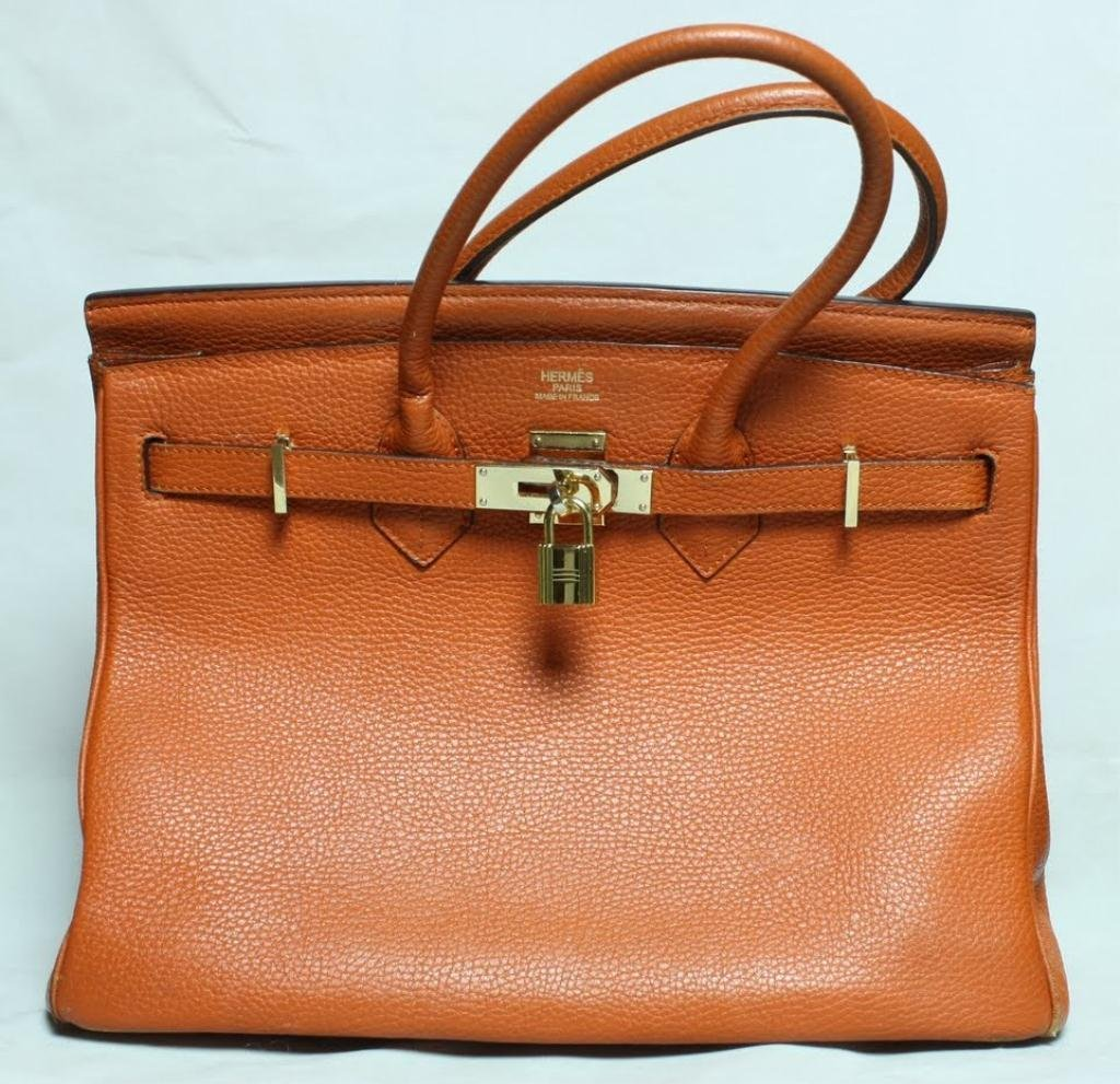 125P: HERMES Leather Purse