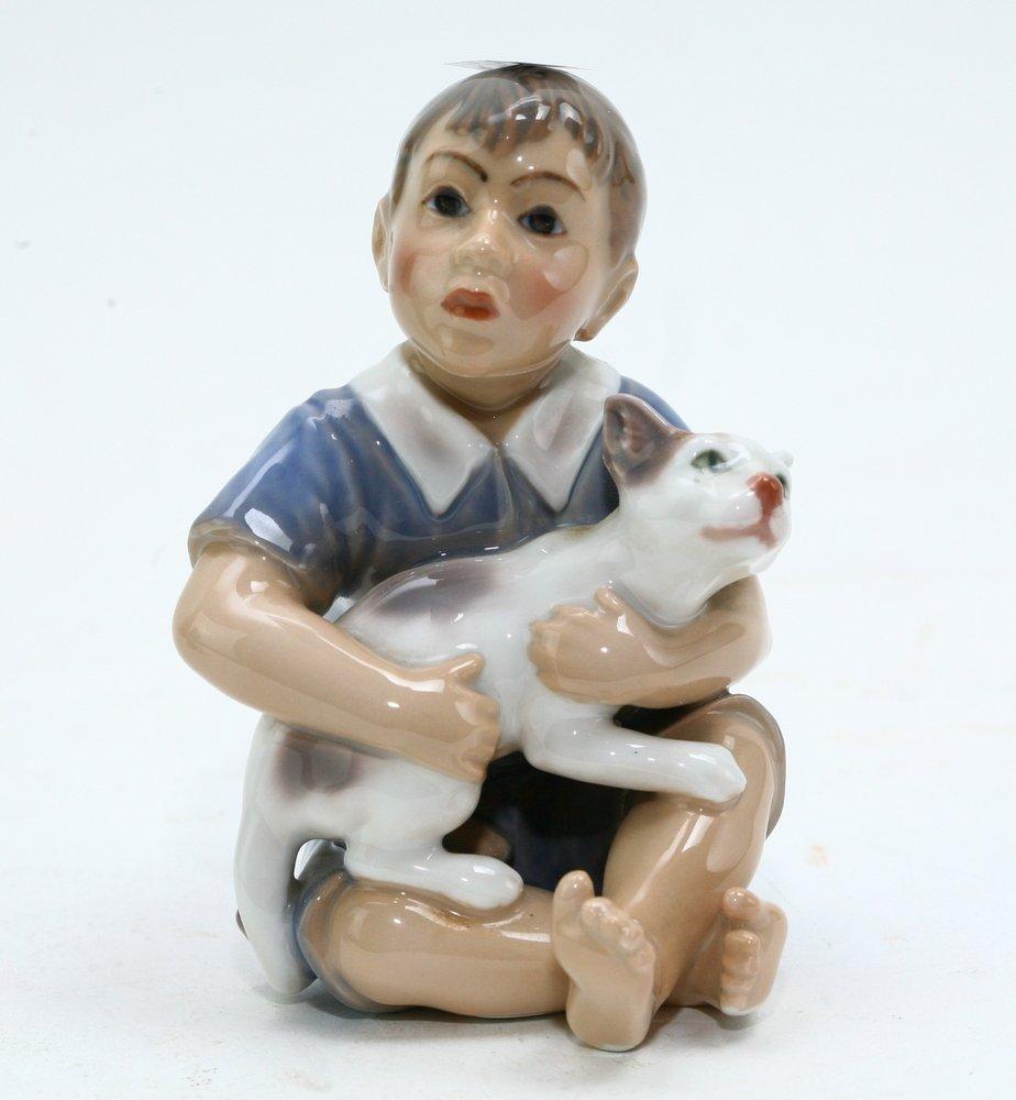 Royal Copenhagen Boy with Dog Figurine