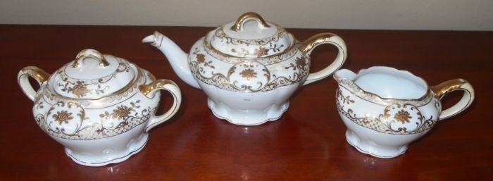 White and Gold Tea Pot, Suger, And Creamer