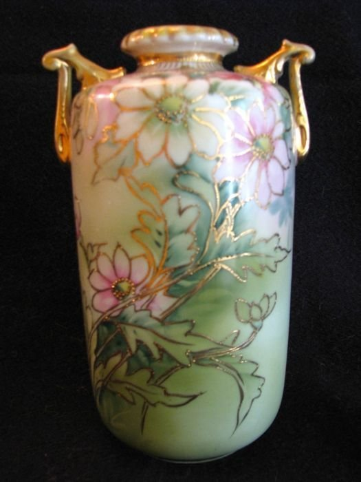 Vase w/ pink and white flowers on green