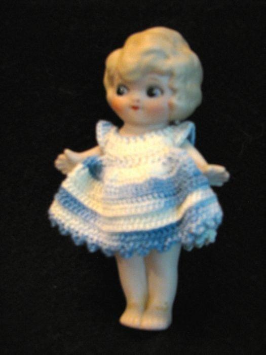 Nippon doll in blue/white crochet dress.