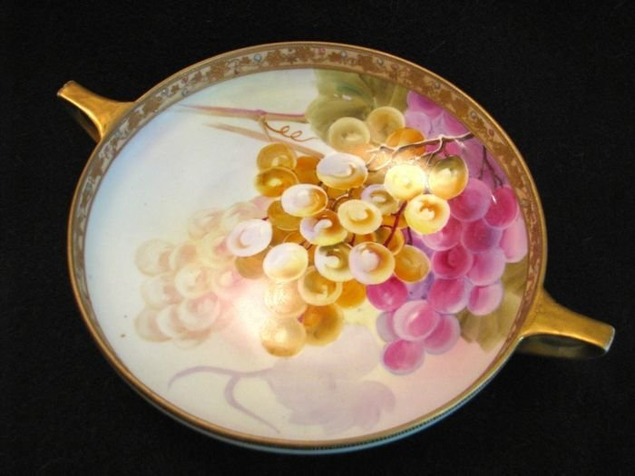 Two-handled bowl w/ grapes.