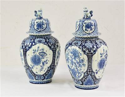 Pair Blue and White urns with Finial
