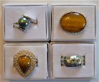 Four Ladies Sterling Silver Colored Stone Rings