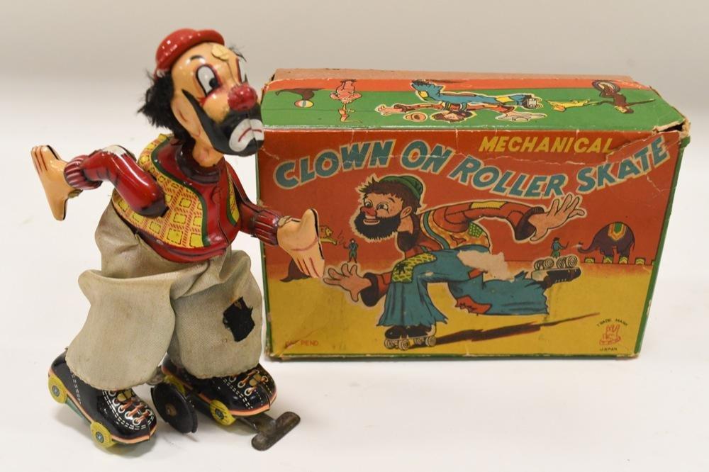 T.P.S. Tin Litho Clown On Roller Skate w/ Box