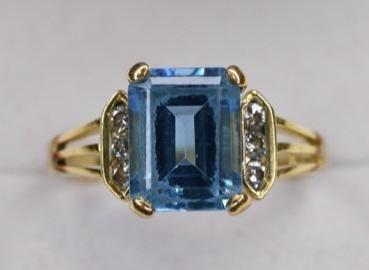 Ladies 14k Yellow Gold Blue Topaz & Diamond Ring
