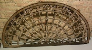 Cast iron transit arch with applied rosettes