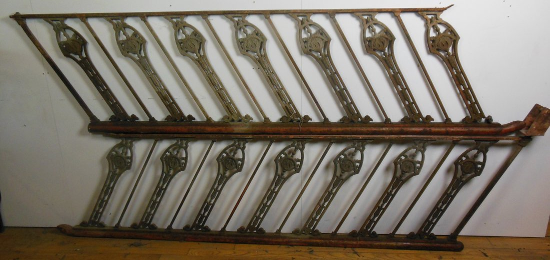 Pair of decorative stair rails, with round iron hand ra