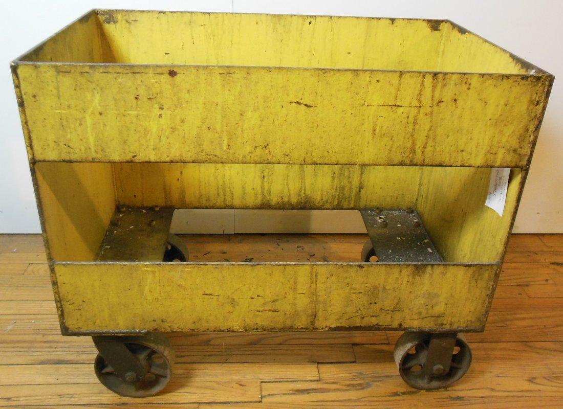American industrial bin painted yellow, on wheels