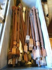 Tote of wooden spindles, some oak, rope spindle, some p