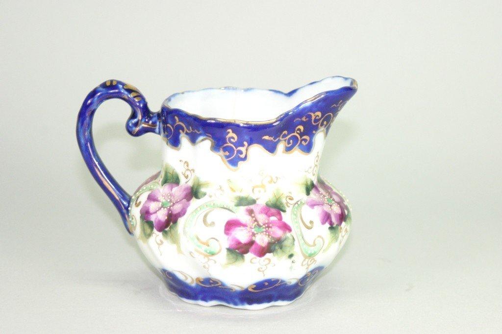 13: Floral Painted porcelain creamer