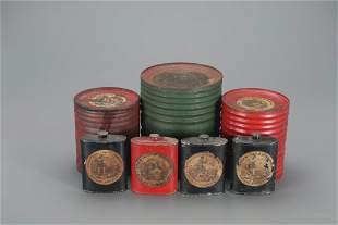 Seven Powder Tins