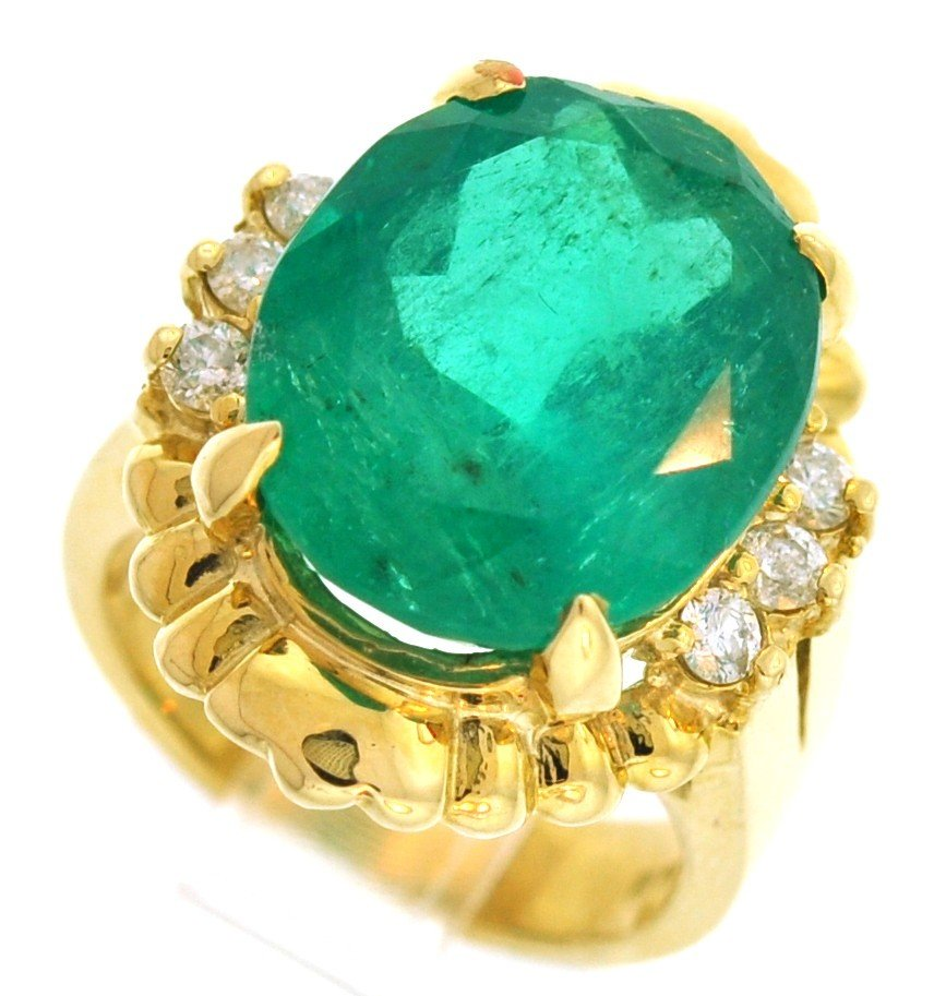 1: 14 kt Ladies ring with .34 ct in dia, 11.80 ct in Em