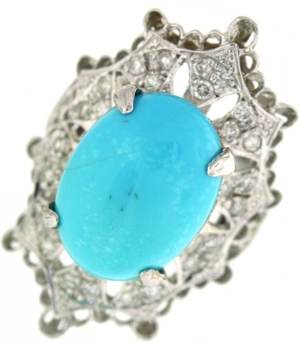 14: 14 kt ring with .51 ct in dia, 6.05 ct in Turquoise