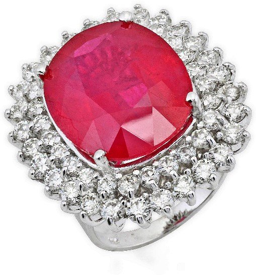 25: 18 kt ring with 3.25 carat in dia, 18.65 carat in R