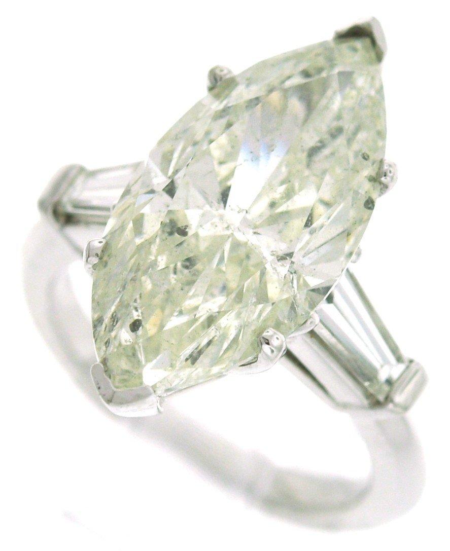 28: Plat ring with 7.88 carat in cnt dia, .70 carat in