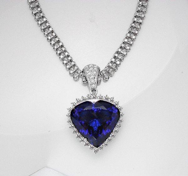 48: 18 kt pendant with 5.54 carat in dia, 122.14 carat