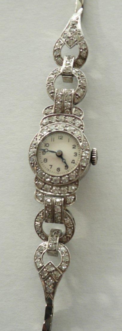 00200A: Diamant-Damenarmbanduhr Art Déco. 585er WG, ges