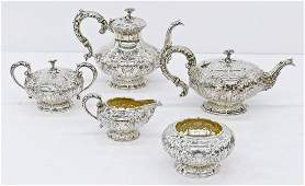 Ornate American Repousse Sterling Tea Service by