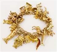 Lady's Heavy 14k Gold Charm Bracelet 8''. Vintage