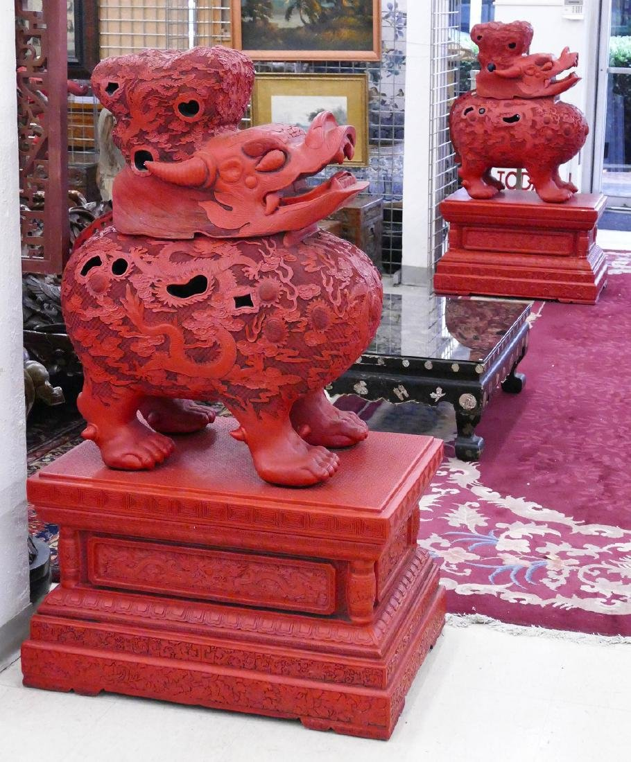Pair of Chinese Monumental Cinnabar Mythological Beast