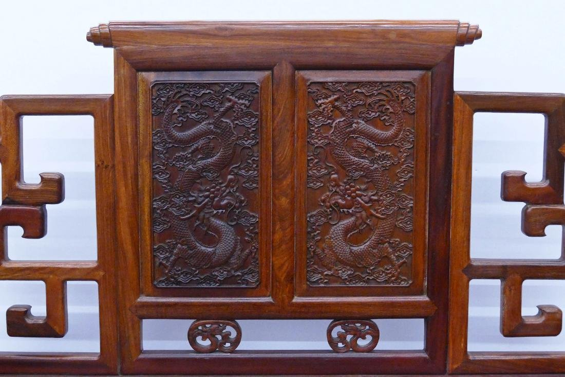 Chinese Rosewood Dragon Settee 40''x47''x23''. A carved - 2