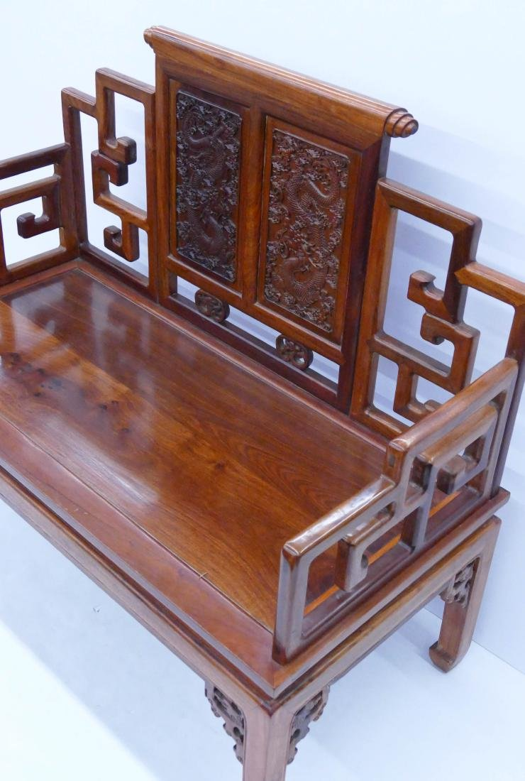 Chinese Rosewood Dragon Settee 40''x47''x23''. A carved - 3