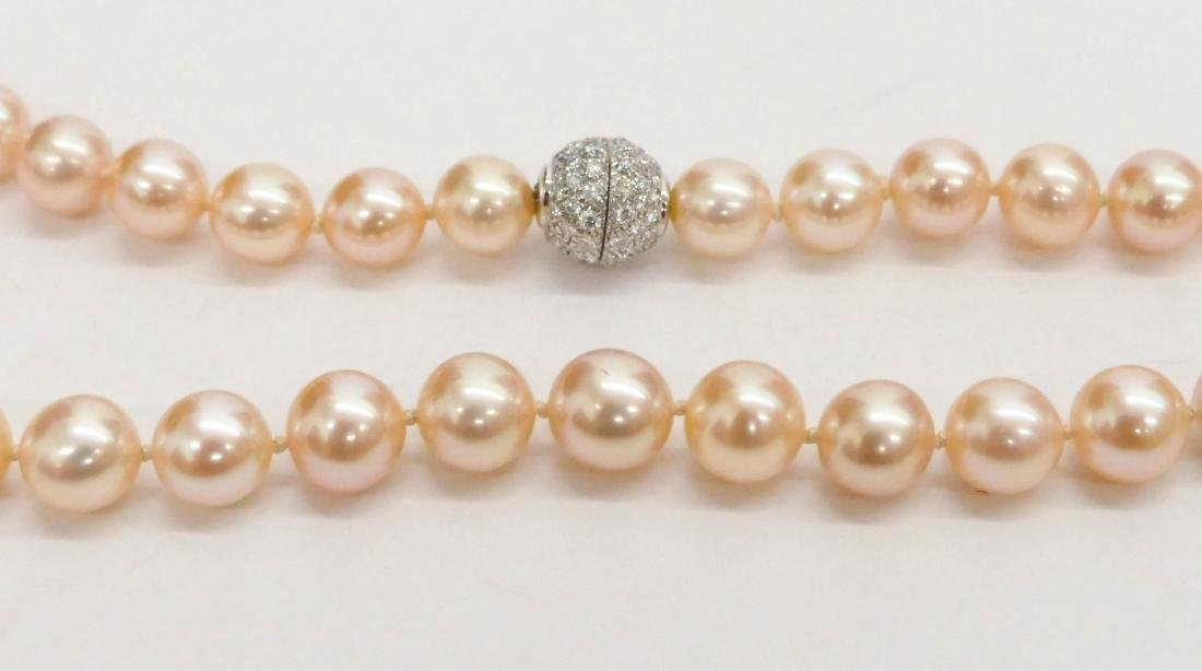 Lady's Peach Pearl & Diamond Necklace 18''. Includes - 2