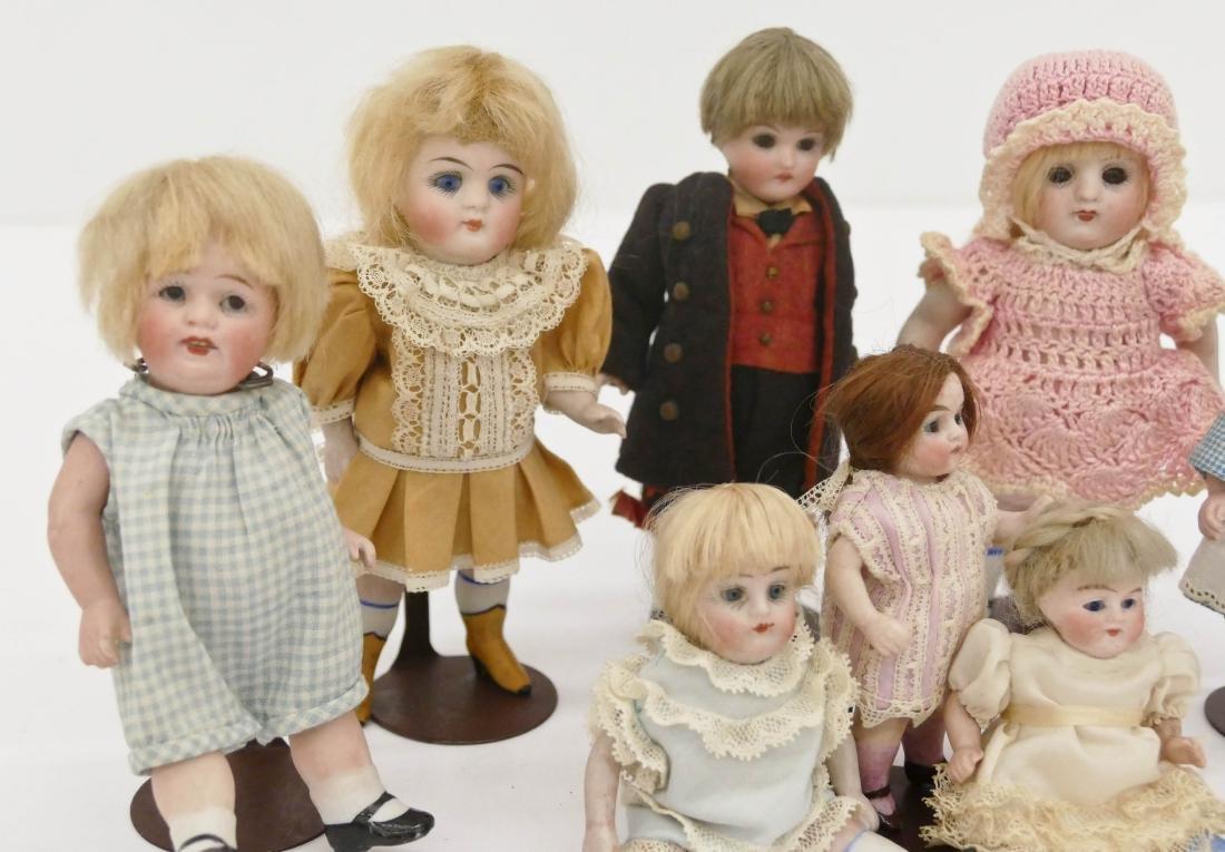 9pc Antique German Bisque Miniature Dolls. Sizes range - 2