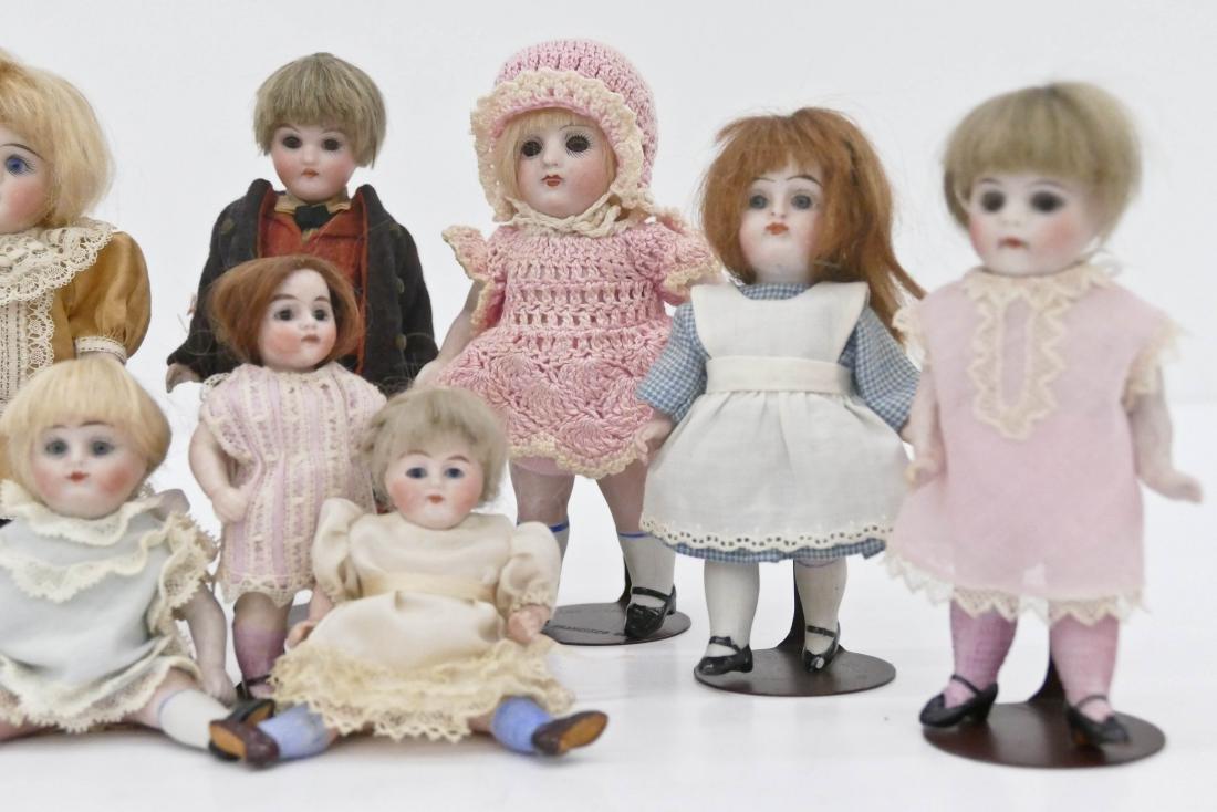 9pc Antique German Bisque Miniature Dolls. Sizes range - 3