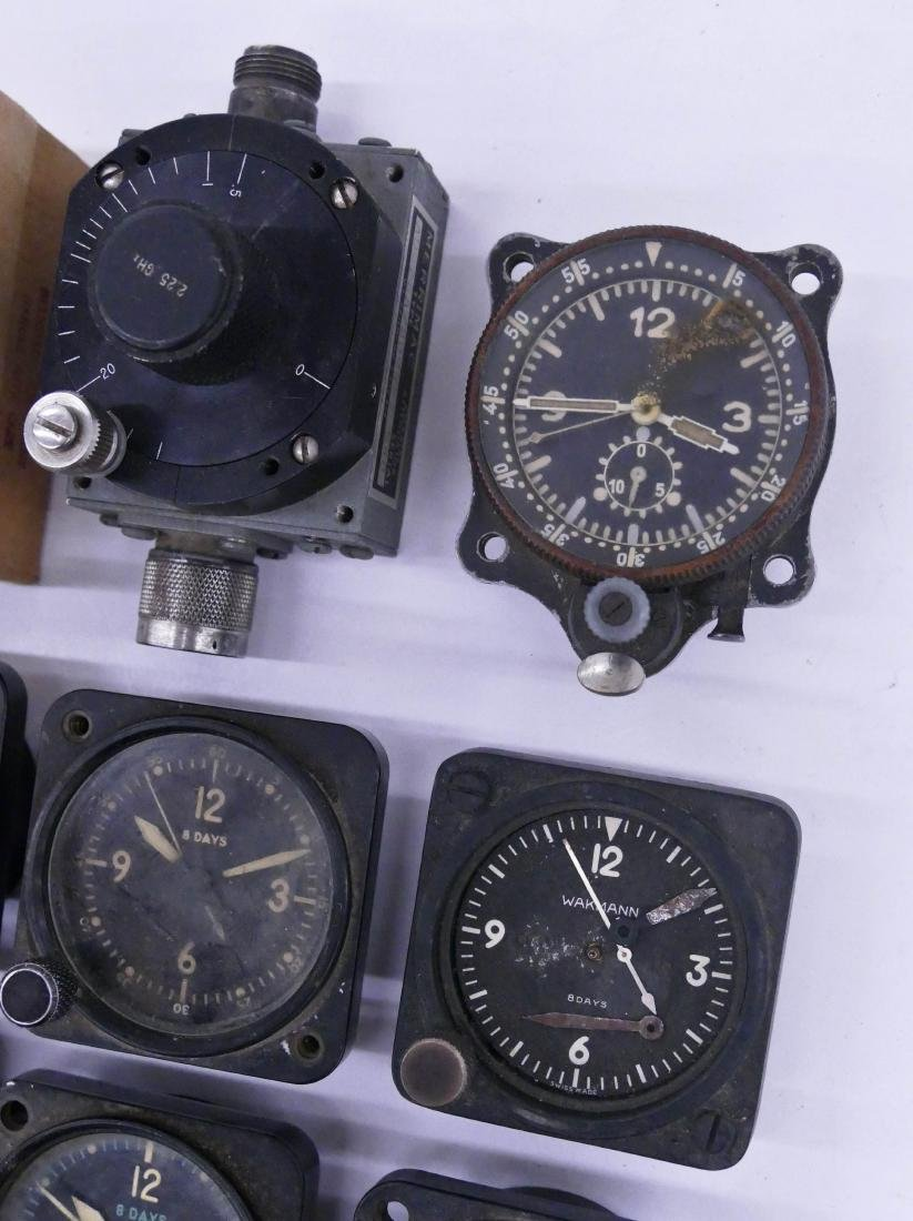13pc WWII Small Aircraft Clocks. Includes pieces by - 3
