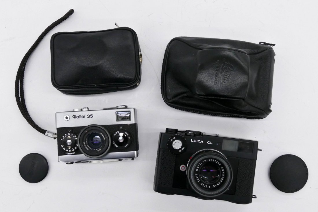 2pc Leica CL and Rollei 35 Cameras. Includes a black bo