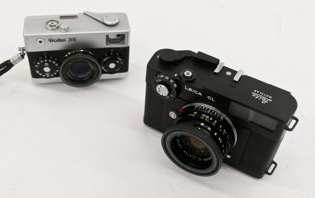 2pc Leica CL and Rollei 35 Cameras. Includes a black bo - 2