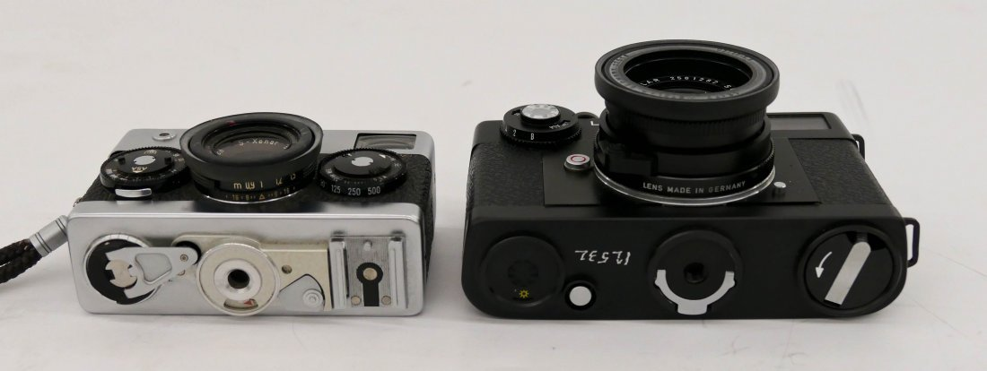 2pc Leica CL and Rollei 35 Cameras. Includes a black bo - 3