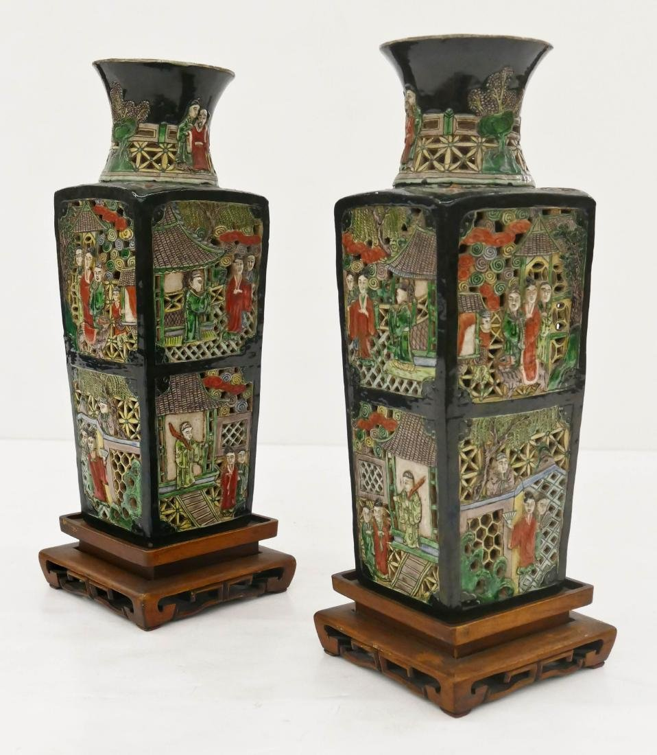 Pair Chinese Famille Noir Reticulated Vases on Stands