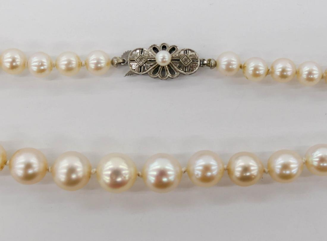 Lady's 14k Pearl Necklace 22''. A long strand including - 2
