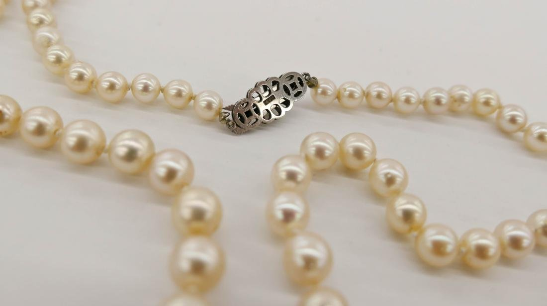 Lady's 14k Pearl Necklace 22''. A long strand including - 3