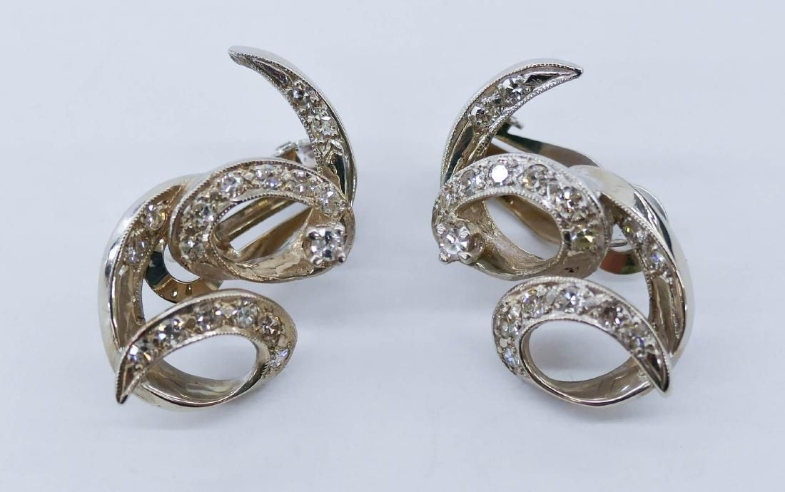 Pair Lady's 14k Diamond Swirl Earrings 1'' Each. They