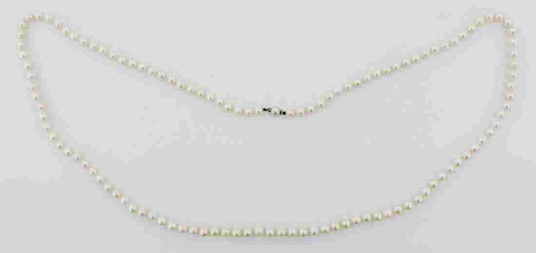 Lady's 14k Saltwater Pearl Flapper Necklace 40''.