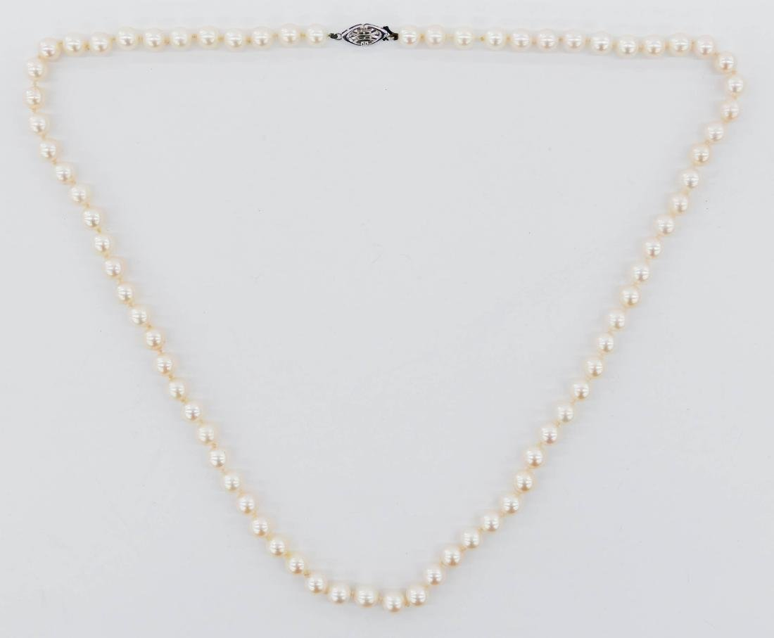 Lady's 14k White Pearl Necklace 24''. Includes (74)