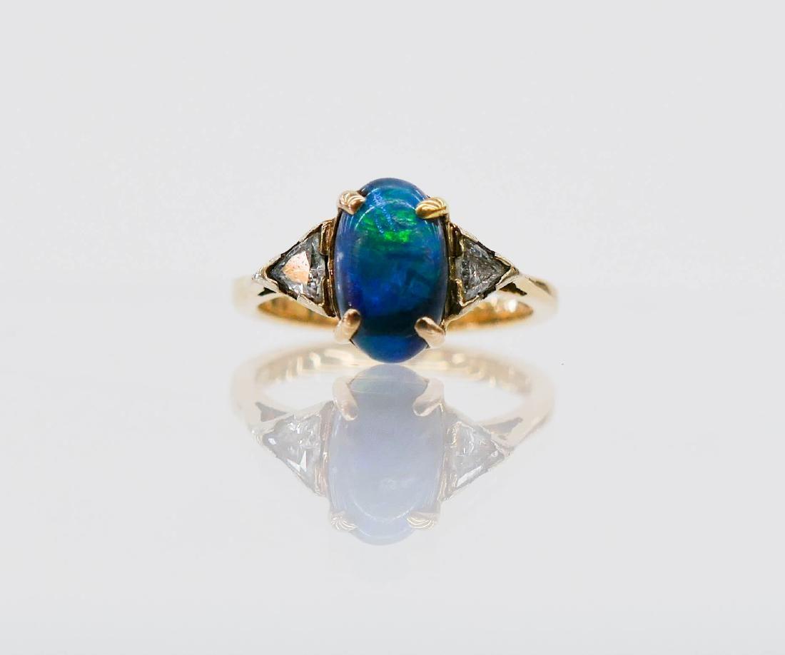 Lady's 14k Black Opal & Diamond Ring Size 5. Includes a