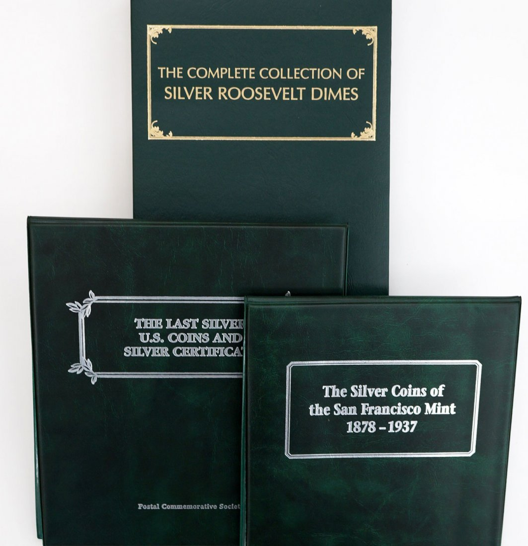 Three U.S. silver coin collector sets in folios.