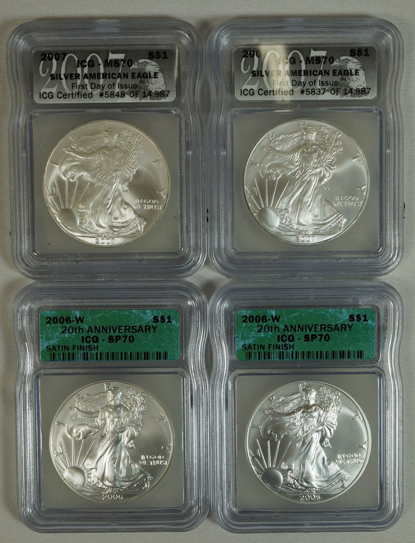 Four graded American Eagle .999 one ounce rounds.