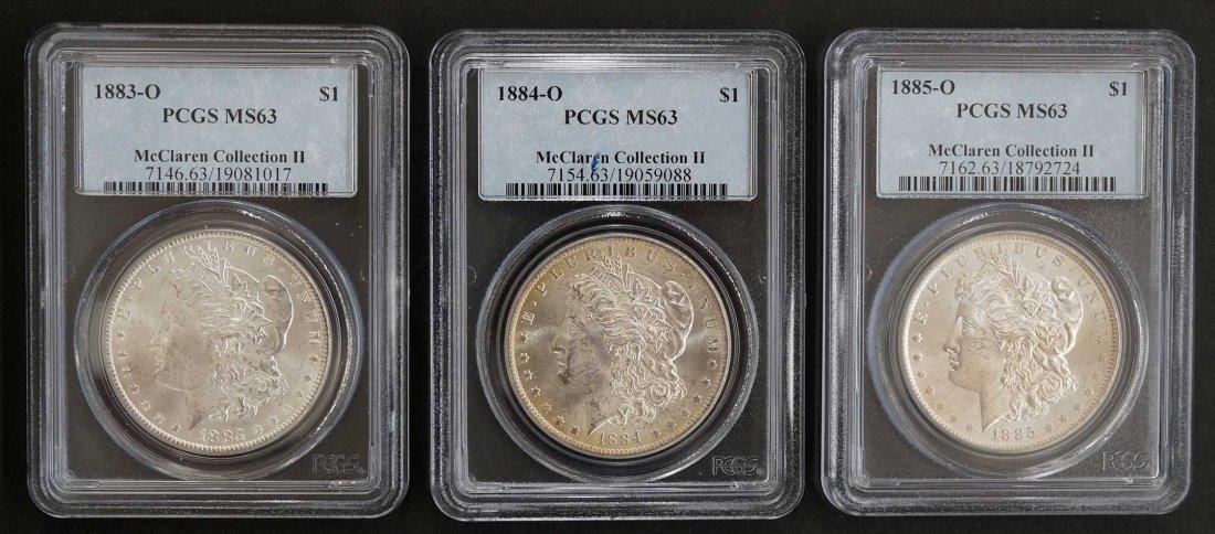 1883-1885 O Three Coin Set of Morgan Dollars. McClaren